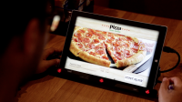 Pizza Hut is trialling a menu that uses retina recognition to determine what customers want