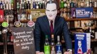 Staff at The Punch Tavern on Fleet Street wore George Osborne masks for the launch of the campaign today